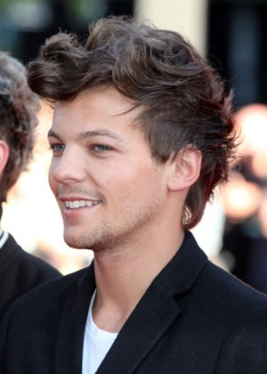 LONDON, ENGLAND - AUGUST 20: (EMBARGOED FOR PUBLICATION IN UK TABLOID NEWSPAPERS UNTIL 48 HOURS AFTER CREATE DATE AND TIME. MANDATORY CREDIT PHOTO BY DAVE M. BENETT/WIREIMAGE REQUIRED) Louis Tomlinson of One Direction attends the World Premiere of 'One Direction: This Is Us 3D' at Empire Leicester Square on August 20, 2013 in London, England. (Photo by Dave M. Benett/WireImage)