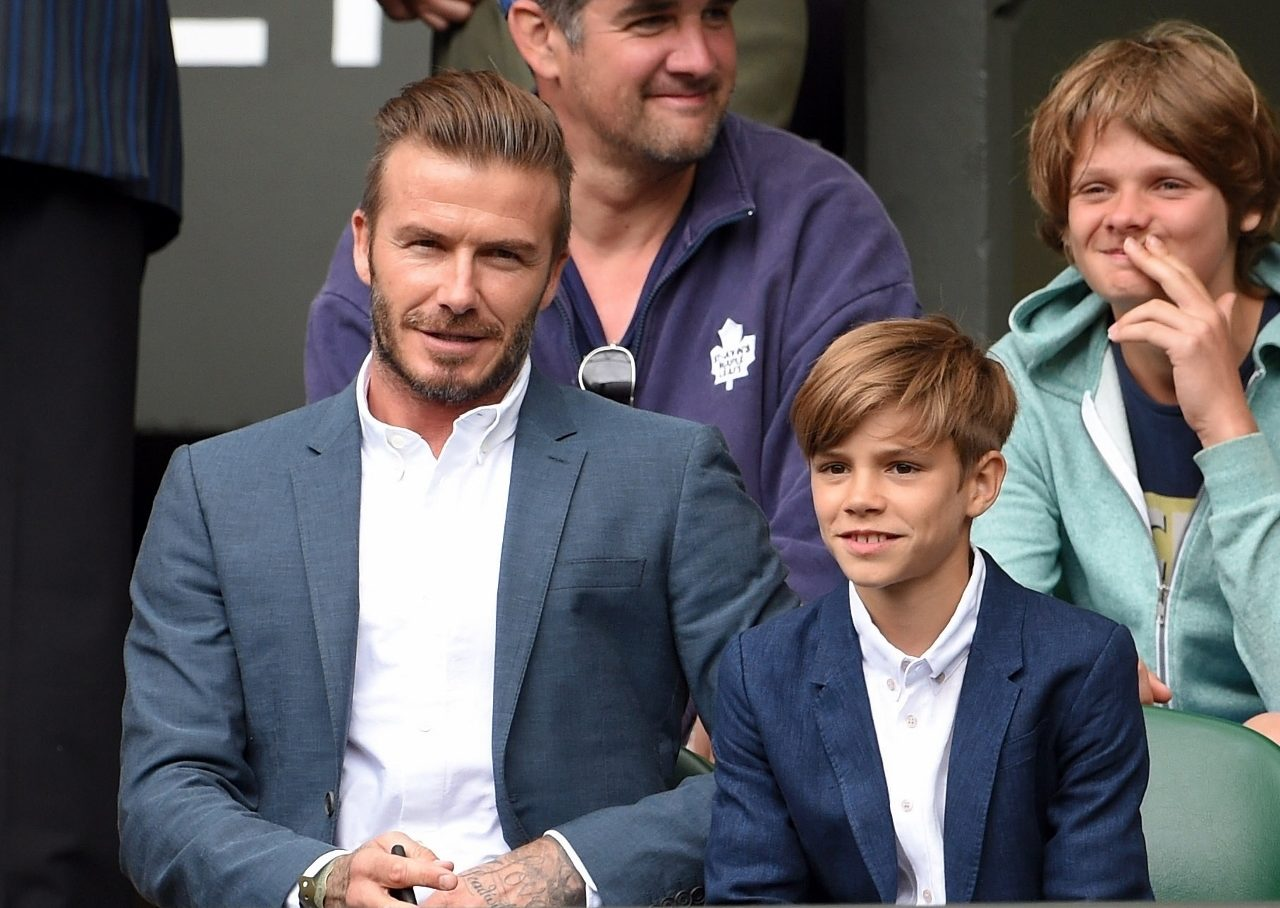 LONDON, ENGLAND - JULY 08: David Beckham and Romeo Beckham attend day nine of the Wimbledon Tennis Championships at Wimbledon on July 8, 2015 in London, England. (Photo by Karwai Tang/WireImage)